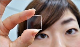 a Japanese woman holding the quartz square