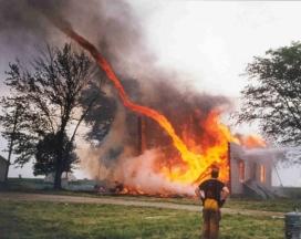Fire tornado destroying house
